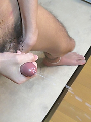 Cute asian boy jerks off and plays with dildo.